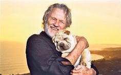 Glad to be wrinkled: country singer Kris Kristofferson, 76, has been living on Maui with his dogs for 30 years.