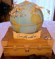 Amazing cake inspired by vintage luggage and globe for a travel-theme celebration