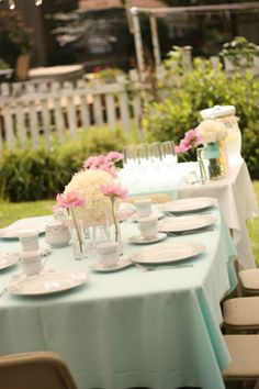 outside tables - have a few waiters in tuxedos  tiffany blue bridal shower