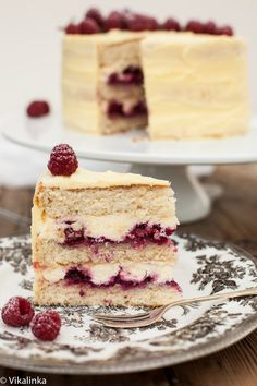 Delicate vanilla cake layers filled with mascarpone cream and raspberry compote and covered with white chocolate buttercream. A dream come true!