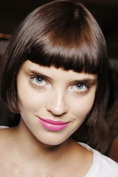 Pink lips, short bob hairstyle.