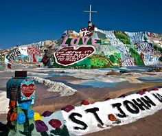Salvation Mountain, Niland, CA (So CA) Creator Leonard Knight's colorful roadside attraction owes its existence to the fact that Knight decided to leave his hometown after he couldn't launch his hot-air balloon in1984. His parting gift was to be a diminutive shrine made from half a bag of cement located on a forgotten riverbank on Beal Road. 25 years—and 100,000 gallons of donated paint later—his psychedelic sculpture is a resplendent display of flowers, waterfalls, scripture, & patriotism.