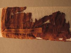 Tablet weaving decorating the sleeve of Bertille (7th cent)