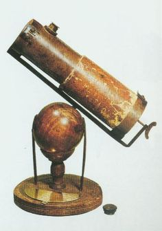 Newton's telescope. The telescope  was focused by turning a screw at the lower end of the tube,  which moved the entire back part of the telescope.