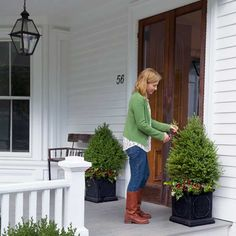 Replant entry pots with winter-hardy specimens, such as dwarf evergreens or boxwood, and ring the base with English ivy and a few faux berries for a festive shot of color. | Photo: John Gruen | thisoldhouse.com