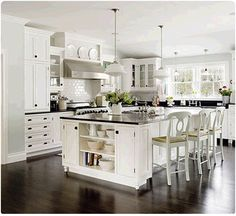Clean white cabinets, dark wood floors, and dark counter tops. This is a good combination. I would prefer a fancier back splash though...