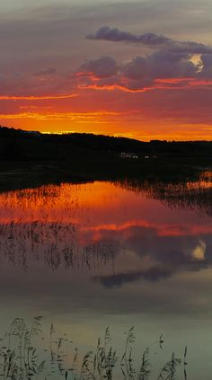 sunset reflecting off of flood waters between Logan and Sawyer, North Dakota. Photo: Wayne Vedvig