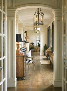 Classic Hallway... love the columns and lanterns.