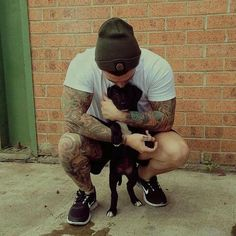 a man with tattoos, a puppy and a soft side. Right up my alley ha