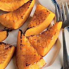 Candied Roasted Squash | A recipe with only three ingredients calls for smart technique and a little bit of finesse. Score the squash flesh to create more surface area for caramelizing. | SouthernLiving.com
