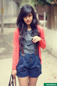 Long wavy black hair with soft side swept bangs. suspenders with shorts and long cardigan // Oona from New Delhi
