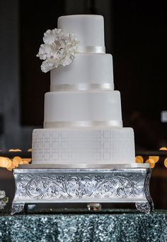 White Wedding Cake with silver accents. From @popevents