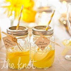 Welcome cocktail - mason jars with yellow striped straws.