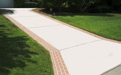Concrete driveway with brick borders.