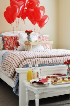 Breakfast in bed with love note heart balloons