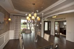 Formal Dining Room with Wainscoting and Box Tray Ceiling by 3 Pillar Homes