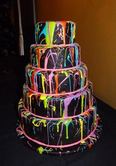 This splatter cake would be fantastic for a Bat Mitzvah if it were splattered with true neon colors.  The rest of the decor could be done in neons with a black light that comes on during the dancing/party part of the event.  13 years-olds would love the glow in the dark effect..