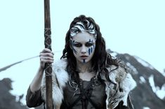 """Norse shamanism. The name """"völva"""" means simply """"woman with a staff"""". The staff, in Norse also called """"gandur"""" (refer to the English word """"wand""""), was a symbol of power and, like in this case, control of the supernatural. The bishop's crozier, the king's sceptre and the magician's magic wand are relics from this special kind of symbolism. The Norse word """"gandur"""" means both wand and magic in modern Faroese and Icelandic."""