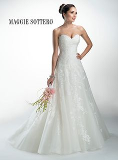 Delilah - wedding dress by Maggie Sottero Guipure lace appliqués adorn tulle in this A-line gown, complete with romantic sweetheart neckline. Finished with fabric covered buttons. Available with corset closure or zipper over inner corset back closure.