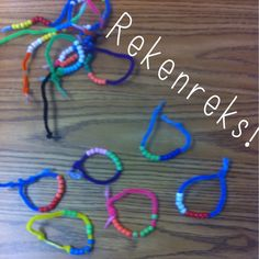 Rekenreks made with pipe cleaners and beads.  Show 2 groups of five.  Great for addition, subtraction, number bonds and subitizing.