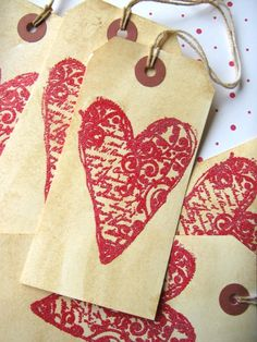 french script tapestry hearts, could be an option to tie on the trees