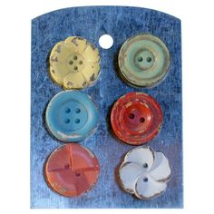 Lend a whimsical touch to your kitchen or home office with this charming magnet set, showcasing multicolor button-inspired designs.