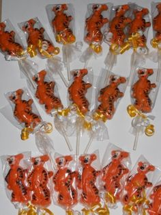 Disney Tigger Gourmet Chocolate Birthday Lollipop Sucker Pops Favors 1 Dozen by Homemade Chocolate from Hannah's secret recipe for over 10 years!, http://www.amazon.com/dp/B005L82X1A/ref=cm_sw_r_pi_dp_Px5Gpb0Y67YQW