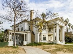 Grand old abandoned house, built 1905. 2218 S Harvard Blvd, Los Angeles, CA. You can click for an article about the house and photos of the interior -- stunning!