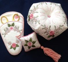 Artistic Designs from ..... http://www.secretsof.com/content/9014 -   The Biscornu needle cushion was embroidered using a 5x7 hoop.  You embroider the two sides the stitch them together using your straight stitch sewing machine.