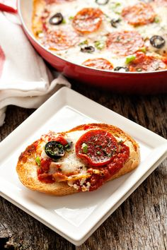 Pizza Dip ~ This dip starts out with a rich cream cheese base and is then covered in zesty pizza sauce.   After the addition of pepperoni, bell peppers, onions, black olives, and most importantly, cheese, this dip will be the hit of the party!