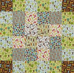 This quilt balances busy prints by strategically placing neutral-background prints. Pay attention to the direction of prints for an organized look or place them randomly for a whimsical look.    Woodland Pals collection by Ann Kelle; @Robert Goris Goris Kaufman Fabrics