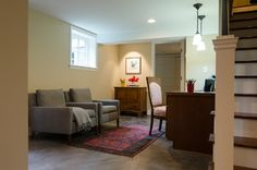 A guest room, a bathroom with shower and a utility room lie beyond the office. Canyon Creek custom built the desk and cabinets here, too.