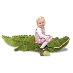 """This Plush Alligator is a soft, friendly chum from the """"wild kingdom""""! It's amazing! Over six feet long, this fabulous stuffed alligator will inspire lots of affectionate hugs. Every wrinkle and ridge adds to the allure and interest of this reptilian friend. With its excellent quality construction, it will withstand lots of friendly wrassling. Measures 10 x 67 x 26"""". Can be found on Amazon by following this link >> http://www.my-linker.com/hop/PlushAlligator"""