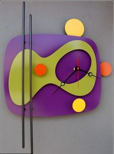 Modern retro clock. This would be perfect with a martini bar and Dean Martin singing in the background. Just sayin'