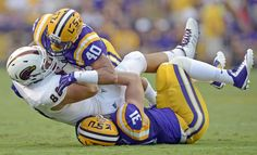 Advocate staff photo by BILL FEIG -- LSU linebackers Duke Riley (40) and D.J. Welter bottle up ULM tight end Harley Scioneaux (88) after a catch during the first quarter of the teams' game Saturday, Sept. 13, 2014 in Baton Rouge.