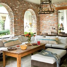 Outdoor living room - brick patio with arched windows and comfortable seating. Love it!