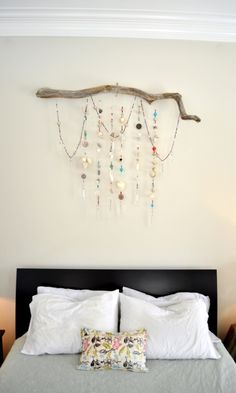 Bedroom sparkle - wall hanging made from strands of beads, seashells, chandelier prisms, buttons, & pieces of jewelry hanging from a driftwood branch.  #wall_hanging #bead #beading #seashell #prism #driftwood #DIY #craft