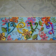 Wood letters and plaque from craft store, scrapbook paper, glue, and paint!   A friend made this for my little girl, so cute!!