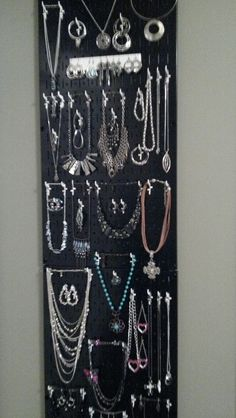 My metal pegboard jewelry organizer behind the door and utilizing a small wasted space of wall.