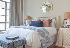 I am always a sucker for white duvet, mixed with mismatched geometric fabric pillows... need to do this in my house
