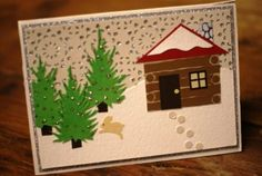 The snowdrifts and glittery treetops on the outside of the card make the inside even cozier!  The front of River North's fabulous creation.