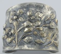 Chased and repousse sterling cuff.