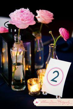 single pink rose in different shaped vases make an elegant centerpiece