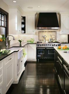 Dark floors, dark counters,  and black accents  make this kitchen pop!