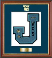 John Jay East Fishkill High School  in New York Varsity Letter Frame - Showcase your varsity letter in our Newport solid hardwood shadowbox frame in cherry finish with black accents and gold lip with hand embossed John Jay East Fishkill High School logo, on our navy and white museum quality matting. A personalized engraved plate is included.