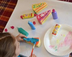 make pretend cakes out of sponges