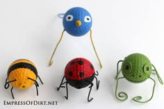 Garden Buggies! Recycled Golf Ball Craft.  How cute would these be in the garden?
