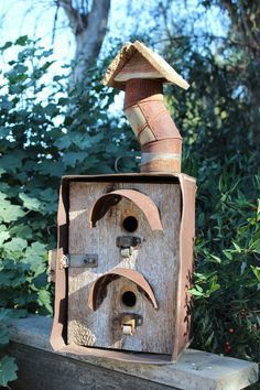 odds and ends of 'junk' to repurpose a bird house