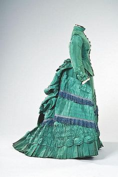 Taffeta visiting gown, circa 1875.  The color's a bit much, but the styling is gorgeous!