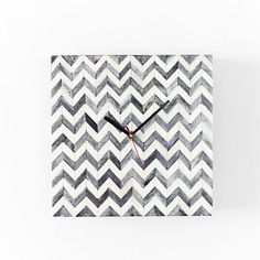 This battery-operated wall clock reinterprets the clean lines and simple detailing of the original iconic Parsons design. Available in three luxe finishes, including Herringbone, it livens up any room.